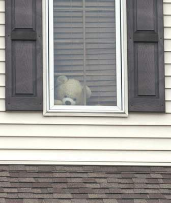 Michelle Davies | The Journal Gazette Homes in The Falls and Laurel Ridge neighborhoods have placed teddy bears in front windows and on porches to provide a scavenger hunt for neighborhood children.