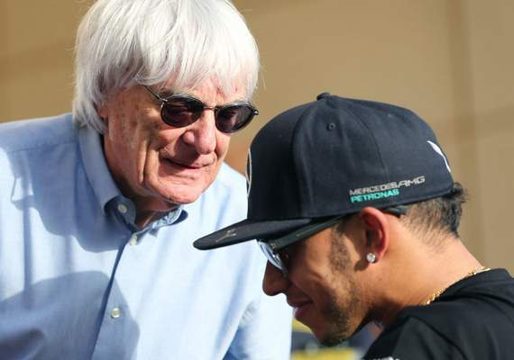 Associated Press Bernie Ecclestone, President and CEO of Formula One Management, left, talks to Lewis Hamilton of Britain in 2015.
