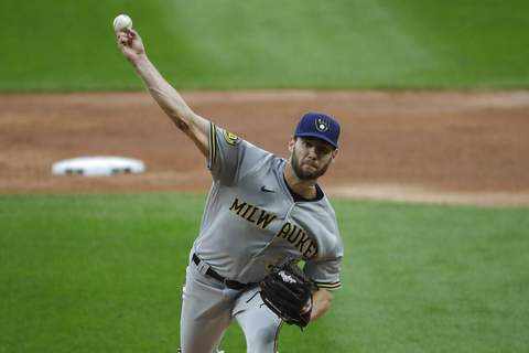 Nam Y. Huh | Associated PressMilwaukee Brewers starting pitcher Adrian Houser throws the ball against the Chicago White Sox during the first inning of a baseball game in Chicago, Wednesday.