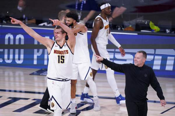 Mark J. Terrill   Associated PressDenver Nuggets center Nikola Jokic (15) and Denver Nuggets head coach Michael Malone, right, celebrates their win over the Los Angeles Clippers in an NBA conference semifinal playoff basketball game Tuesday, in Lake Buena Vista, Fla.