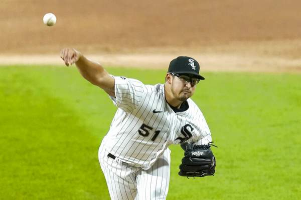 Charles Rex Arbogast | Associated PressChicago White Sox starting pitcher Dane Dunning delivers during the first inning of the team's baseball game against the Minnesota Twins on Tuesday, in Chicago.