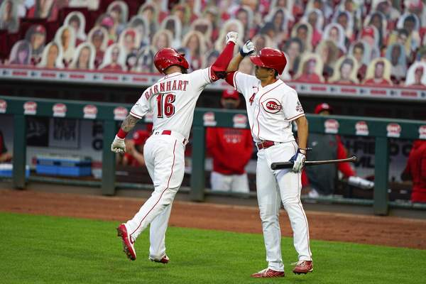 Bryan Woolston | Associated PressCincinnati Reds' Tucker Barnhart (16) celebrates with Shogo Akiyama (4) after hitting a home run during the second inning of the team's baseball game against the Pittsburgh Pirates in Cincinnati, Tuesday.