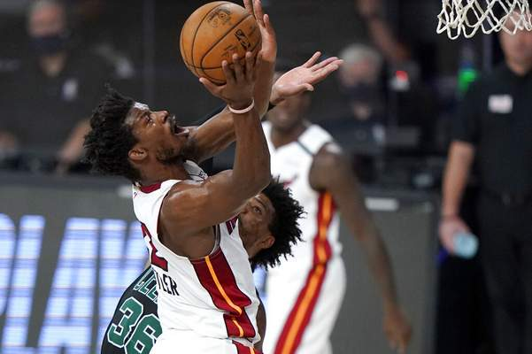Mark J. Terrill | Associated PressMiami Heat's Jimmy Butler, front, goes up for a shot over Boston Celtics' Marcus Smart, rear, during the first half of an NBA conference final playoff basketball game, Tuesday, in Lake Buena Vista, Fla.