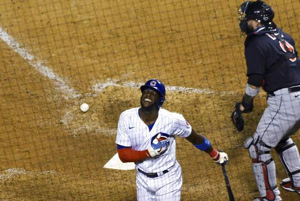 David Banks | Associated PressChicago Cubs' Cameron Maybin reacts after being hit by a pitch with the bases loaded, scoring the winning run during the ninth inning of the team's baseball game against the Cleveland Indians, Tuesday, in Chicago.