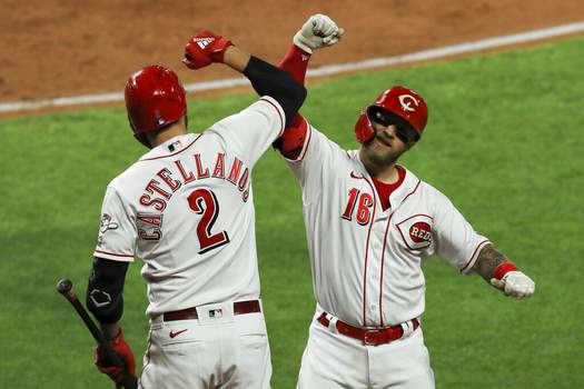 Aaron Doster | Associated PressCincinnati Reds' Nick Castellanos, left, and Tucker Barnhart celebrates Barnhart's solo home run during the third inning of the team's baseball game against the Chicago White Sox in Cincinnati, Friday.