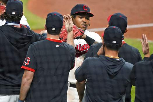 Tony Dejak | Associated PressCleveland Indians' Jose Ramirez is congratulated by teammates after the Indians defeated the Chicago White Sox 5-4 in a baseball game Thursday, in Cleveland.