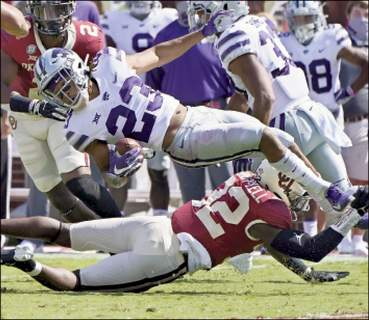 Associated Press Kansas State wide receiver Joshua Youngblood is upended by Oklahoma defensive back Delarrin Turner-Yell, bottom, in the first half Saturday in Norman, Okla.