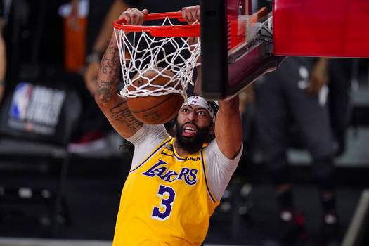 Mark J. Terrill | Associated PressLos Angeles Lakers' Anthony Davis (3) slams a dunk against the Miami Heat during the second half of Game 1 of basketball's NBA Finals Wednesday, in Lake Buena Vista, Fla.