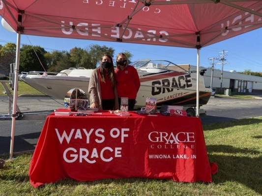 Courtesy Grace College is trying a new recruitment approach this fall bybringingits boat to high school parking lots, where representatives also set up an information booth.