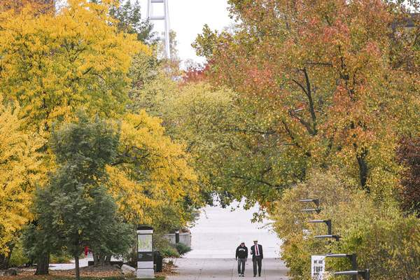 Mike Moore | The Journal Gazette A student walks with a teacher on Wednesday at Purdue University Fort Wayne.