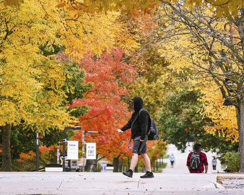 Mike Moore | The Journal Gazette Students walk to class on Wednesday at Purdue University Fort Wayne.