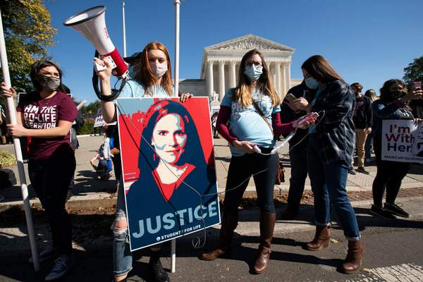 Although the marches' theme was opposition to President Donald Trump, backers of his Supreme Court nominee, Amy Coney Barrett, held a a counterrally outside the court in Washington.
