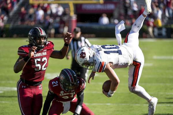 Sean Rayford | Associated PressAuburn quarterback Bo Nix (10) is knocked out of bounds by South Carolina defensive back Shilo Sanders (21) and Kingsley Enagbare (52) during the second half of an NCAA college football game Saturday, in Columbia, S.C. South Carolina defeated Auburn 30-22.