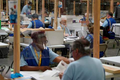 Associated Press Election workers process mail-in ballots during a nearly all-mail primary election in Las Vegas. The Trump campaign and Nevada Republicans want a state judge to stop the counting of Las Vegas-area mail-in ballots.