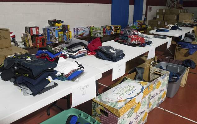 Michelle Davies | The Journal Gazette A table of boy's donated items at the Salvation Army.