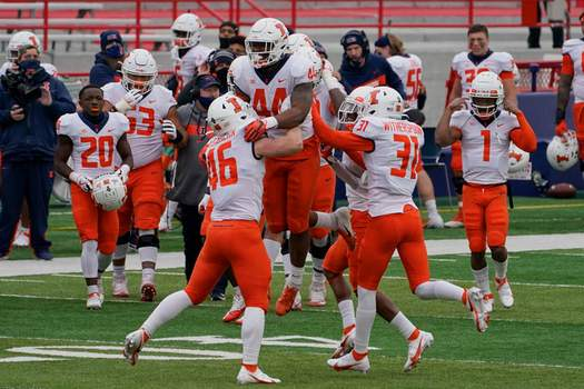 Associated Press Illinois linebacker Tarique Barnes, center, celebrates with teammates after he intercepted a pass by Nebraska quarterback Luke McCaffrey during the first half Saturday in Lincoln, Neb.