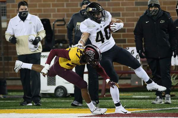 Associated Press Purdue running back Zander Horvath  tries to stay upright as he's hit by Minnesota defensive back Tyler Nubin on Friday.