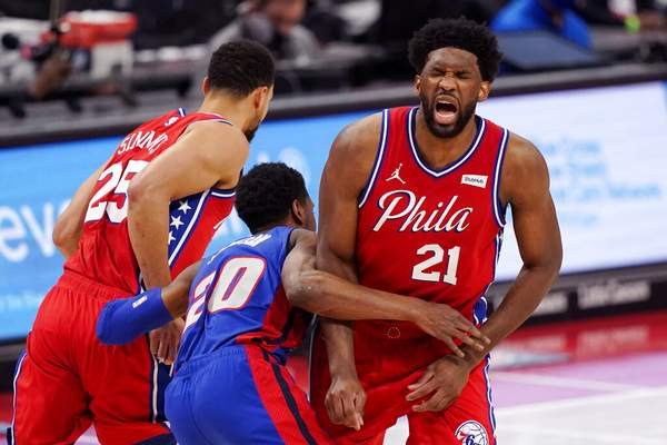 Carlos Osorio | Associated PressPhiladelphia 76ers center Joel Embiid (21) grimaces after Detroit Pistons guard Josh Jackson (20) ran into him while chasing guard Ben Simmons (25) during the first half of an NBA basketball game Saturday, in Detroit.