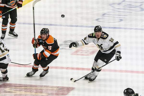 Zack Rawson | Special to The Journal Gazette The Komets' Nolan LaPorte, left, and Wheeling's Brady Tomlak chase the puck after it's flipped past the blue line.