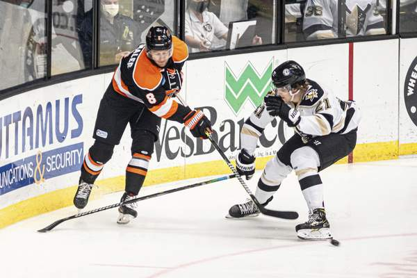 Zack Rawson | Special to The Journal Gazette The Komets' Blake Siebanaler, making his Fort Wayne debut against his former team, is defended by the Wheeling Nailers' Matt Alfaro on Friday in Wheeling.