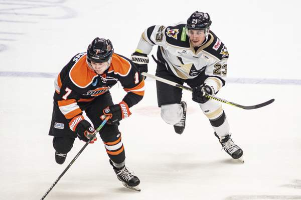 Zack Rawson | Special to The Journal Gazette  Brandon Hawkins, making his Komets debut against his former team, is chased by Michael Pelech of the Wheeling Nailers on Friday at Wheeling, West Virginia.