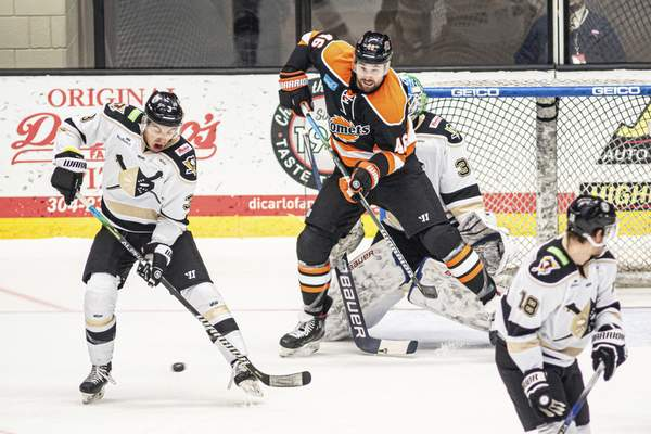 Zack Rawson | Special to The Journal Gazette  Justin Vaive, in his first game for the Komets, camps out in front of the Wheeling net on Friday and tries to deflect a shot at WesBanco Arena in Wheeling, West Virginia.