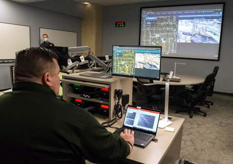 Michelle Davies   The Journal Gazette Lt. Jon Bowers demonstrates how live drone footage can be viewed in the newly created Investigative Operations Center at the Fort Wayne Police Department.