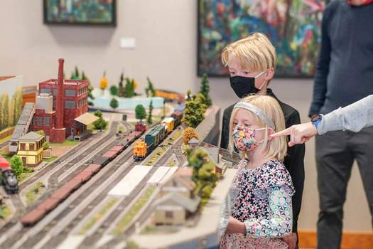 Photos by Mike Moore   The Journal Gazette Opal Heath, 6, and brother Foster Heath, 9, get an up-close look at model trains on display at Foellinger-Freimann Botanical Conservatory on Saturday during the Great Train Connection event.