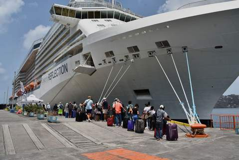 Associated Press On the Caribbean island of St. Vincent, British, Canadian and U.S. nationals line up alongside the Royal Caribbean cruise ship Reflection to be evacuated Friday because of recent volcanic eruptions.