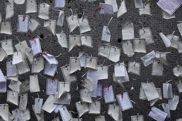 Associated Press Messages written by loved ones and dedicated to the deceased hang from a wall at a memorial for COVID-19 victims Wednesday installed outside the Basilica of Guadalupe in Mexico City.