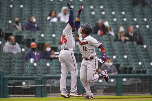 Paul Sancya | Associated PressMinnesota Twins' Jorge Polanco (11) celebrates his solo home run with third base coach Tony Diaz (46) against the Detroit Tigers in the second inning of a baseball game in Detroit, Friday.