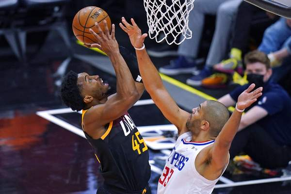 Rick Bowmer   Associated PressLos Angeles Clippers forward Nicolas Batum (33) defends as Utah Jazz guard Donovan Mitchell, left, goes to the basket during the first half of Game 2 of a second-round NBA basketball playoff series Thursday, in Salt Lake City.