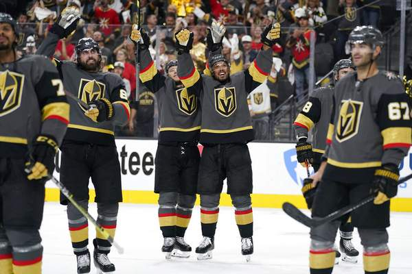 John Locher | Associated PressVegas Golden Knights center William Karlsson, center left, and Vegas Golden Knights right wing Keegan Kolesar, center right, celebrate with teammates after defeating the Colorado Avalanche in Game 6 of an NHL hockey Stanley Cup second-round playoff series Thursday, in Las Vegas.