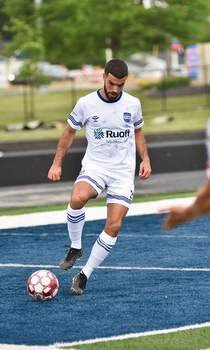 Katie Fyfe | The Journal Gazette Fort Wayne FC forward Noe Garcia kicks the ball during the first half against South Bend at Shields Field on June 6.