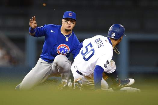 Kelvin Kuo | Associated PressChicago Cubs shortstop Javier Baez, left tags out Los Angeles Dodgers' Mookie Betts to complete a double play off an infield ground ball to fielder's choice by Max Muncy during the eighth inning of a baseball game in Los Angeles, Thursday.