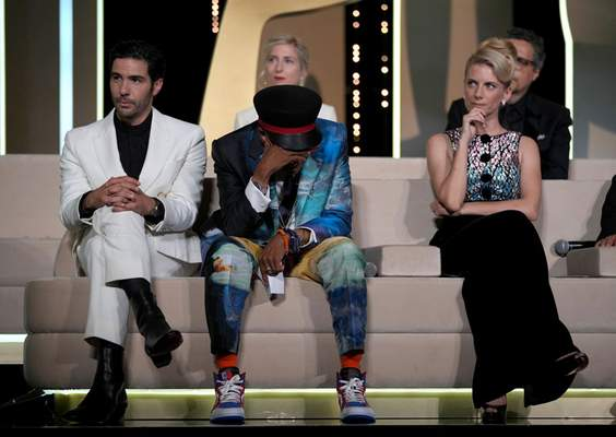 """Associated Press Cannes jury president Spike Lee holds his head in hands after accidentally revealing """"Titane"""" as the winner of the Palme d'Or at the beginning of Saturday's awards ceremony instead at the end."""