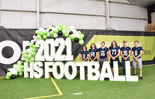 Katie Fyfe   The Journal Gazette Bishop Dwenger football players pose for a photo during media day at Empowered Sports on Friday.