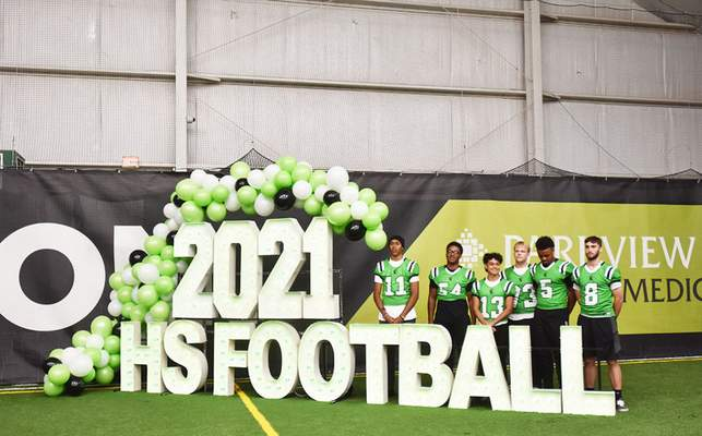 Katie Fyfe   The Journal Gazette  South Side High School football players pose for a photo during Media Day at Empowered Sports on Friday.