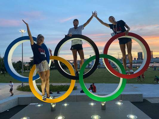 Courtesy photos April Ross, left, and Alix Klineman, the world's second-ranked women's beach volleyball team, flank their coach, Angie Akers, a Bishop Luers and Notre Dame graduate, for a photo this week in Tokyo.