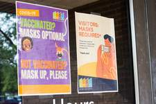 Katie Fyfe | The Journal Gazette A sign at Grile Administrative Center outlines Fort Wayne Community Schools' mask policy. The signs were created before the CDC  updated its mask guidelines Tuesday.
