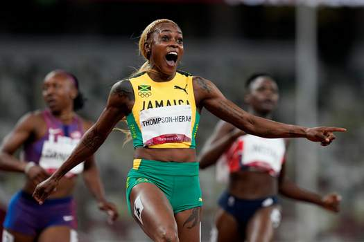 Associated Press Elaine Thompson-Herah of Jamaica celebrates after winning the 100-meter final Saturday at the Summer Olympics in Tokyo.