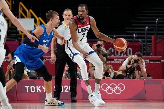 Associated Press The United States' Kevin Durant is guarded by the Czech Republic's Jan Vesely during Olympic play Saturday in Saitama, Japan.