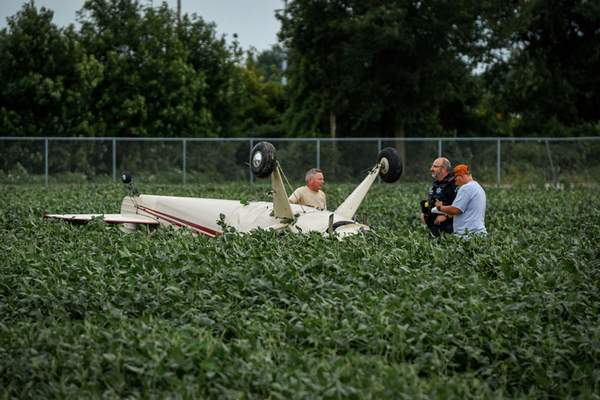 Mike Moore | The Journal Gazette Members of the Fort Wayne Police Department respond to a small plane crash Saturday at Smith Field on W. Cook Rd.
