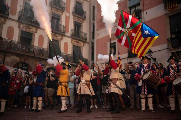 Associated Press Costumed men fire rifles to celebrate Catalan National Day on Saturday in Barcelona, Spain. Thousands of Catalan independence supporters took to the streets for a march and speeches organized by a grassroots movement.