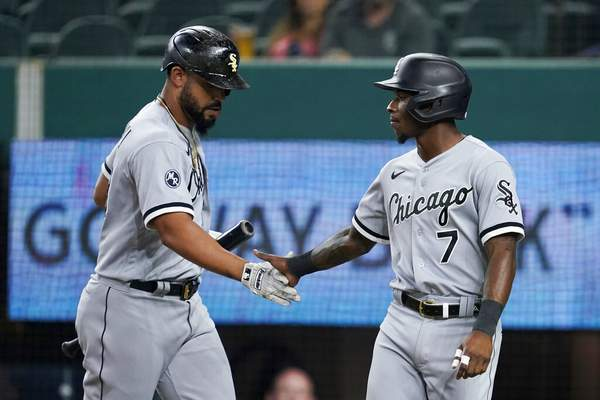 Tony Gutierrez | Associated PressChicago White Sox's Jose Abreu, left, and Tim Anderson celebrate after Anderson scored on a sacrifice fly by Abreu during the first inning of the team's baseball game against the Texas Rangers in Arlington, Texas, Friday.