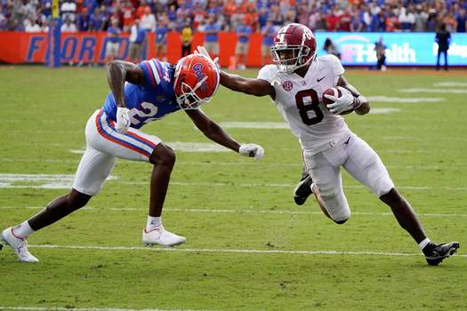 Associated Press Alabama wide receiver John Metchie III stiff-arms Florida cornerback Avery Helm during the second half Saturday in Gainesville, Fla.