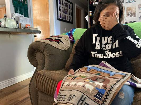 Associated Press Holding a rug made by her aunt, Ella Mae Begay, Seraphine Warren cries at her home in Tooele, Utah, as she talks about Begay, 62, missing since June.