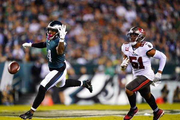 Matt Rourke   Associated PressPhiladelphia Eagles running back Kenneth Gainwell (14) misses a pass in front of Tampa Bay Buccaneers linebacker Kevin Minter (51) during the first half of an NFL football game Thursday, in Philadelphia.