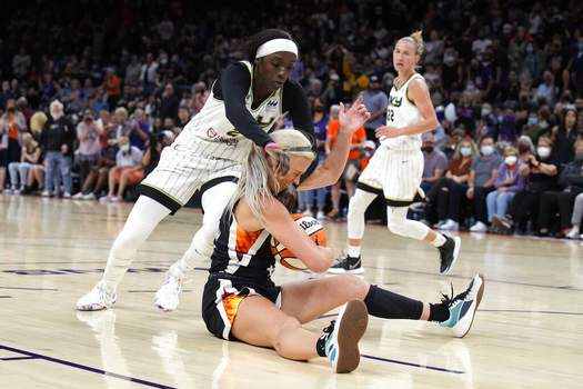 Rick Scuteri | Associated PressChicago Sky forward Kahleah Copper (2) and Phoenix Mercury guard Sophie Cunningham (9) compete for a loose ball during the first half of Game 2 of basketball's WNBA Finals, Wednesday, in Phoenix.