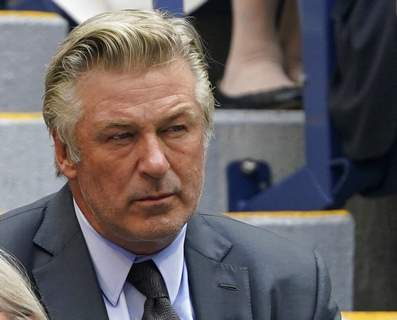 John Minchillo, File | Associated PressFILE - In this Sunday, photo Alec Baldwin watches the men's singles final of the US Open tennis championships in New York. A prop firearm discharged by veteran actor Alec Baldwin, who is starring and producing a Western movie, killed his director of photography and injured the director Thursday, N.M., the Santa Fe County Sheriff's Office said.